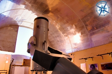 The telescope is seen while the main door is opening.